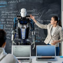 Clever girl standing by blackboard and describing robot characteristics
